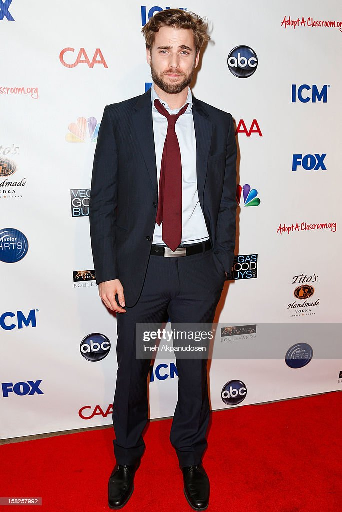 Actor Dustin Milligan attends the Junior Hollywood Radio & Television Society (JHRTS) Holiday Party at Boulevard3 on December 11, 2012 in Hollywood, California.