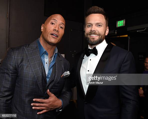 Actor Dwayne Johnson and host Joel McHale backstage at the People's Choice Awards 2017 at Microsoft Theater on January 18 2017 in Los Angeles...