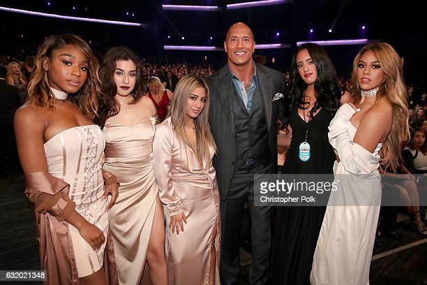 Actor Dwayne Johnson and Simone Alexandra Johnson pose with recording artists Normani Kordei Lauren Jauregui Ally Brooke and Dinah Jane of music...