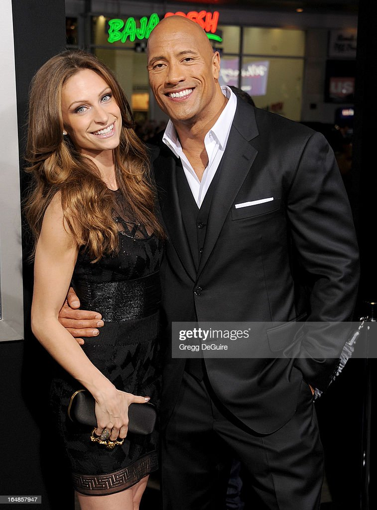 Actor <a gi-track='captionPersonalityLinkClicked' href=/galleries/search?phrase=Dwayne+Johnson&family=editorial&specificpeople=210704 ng-click='$event.stopPropagation()'>Dwayne Johnson</a> (R) and singer Lauren Hashian arrive at the 'G.I. Joe: Retaliation' Los Angeles premiere at TCL Chinese Theatre on March 28, 2013 in Hollywood, California.