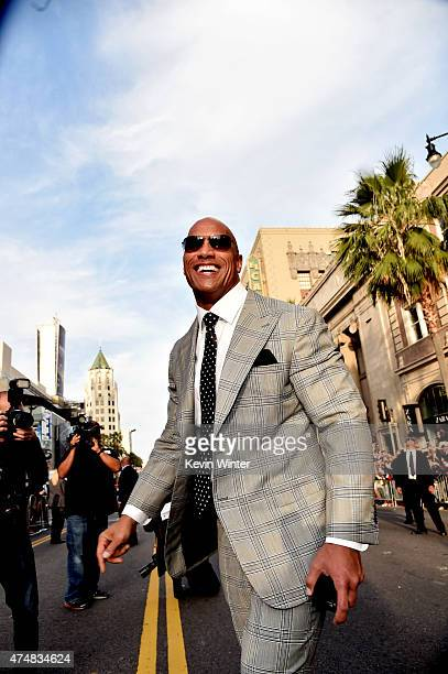 Actor Dwayne Johnson arrives at the premiere of Warner Bros Pictures' 'San Andreas' at the Chinese Theatre on May 26 2015 in Los Angeles California