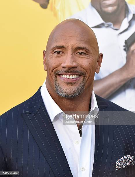 Actor Dwayne Johnson arrives at the premiere of Warner Bros Pictures' 'Central Intelligence' at Westwood Village Theatre on June 10 2016 in Westwood...