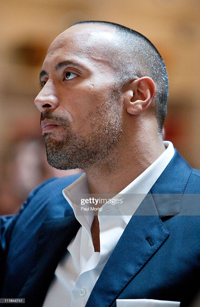 Actor <a gi-track='captionPersonalityLinkClicked' href=/galleries/search?phrase=Dwayne+Johnson&family=editorial&specificpeople=210704 ng-click='$event.stopPropagation()'>Dwayne Johnson</a> attends The Motion Picture Association of America's 'Business of Show Business' symposium at the Hotel Monaco on April 21, 2009 in Washington, DC.