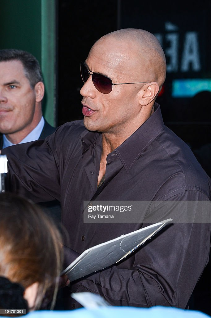 Actor Dwayne Johnson enters the 'Good Morning America' taping at the ABC Times Square Studios on March 27, 2013 in New York City.