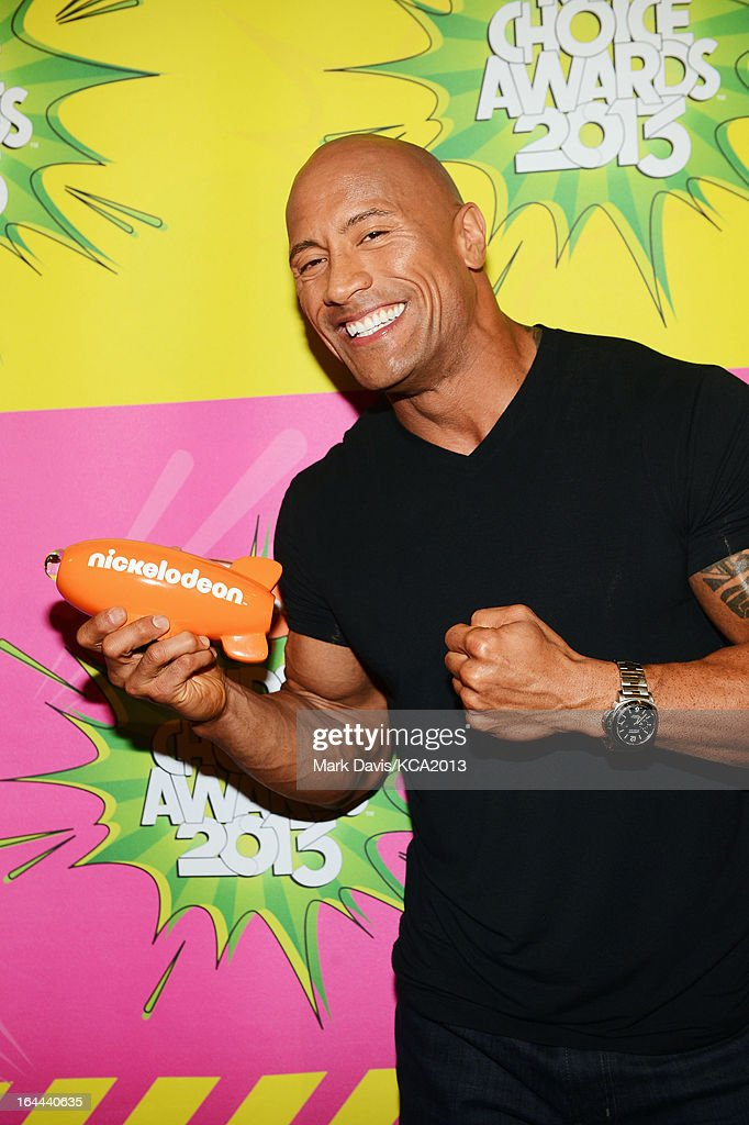 Actor <a gi-track='captionPersonalityLinkClicked' href=/galleries/search?phrase=Dwayne+Johnson&family=editorial&specificpeople=210704 ng-click='$event.stopPropagation()'>Dwayne Johnson</a> holds the Kids' Choice Award for Favorite Male Buttkicker backstage at Nickelodeon's 26th Annual Kids' Choice Awards at USC Galen Center on March 23, 2013 in Los Angeles, California.