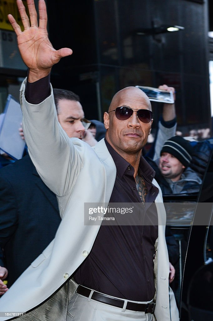 Actor Dwayne Johnson leaves the 'Good Morning America' taping at the ABC Times Square Studios on March 27, 2013 in New York City.