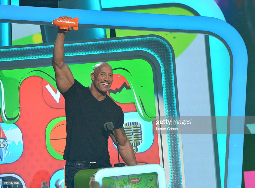 Actor <a gi-track='captionPersonalityLinkClicked' href=/galleries/search?phrase=Dwayne+Johnson&family=editorial&specificpeople=210704 ng-click='$event.stopPropagation()'>Dwayne Johnson</a> performs during Nickelodeon's 26th Annual Kids' Choice Awards at USC Galen Center on March 23, 2013 in Los Angeles, California.