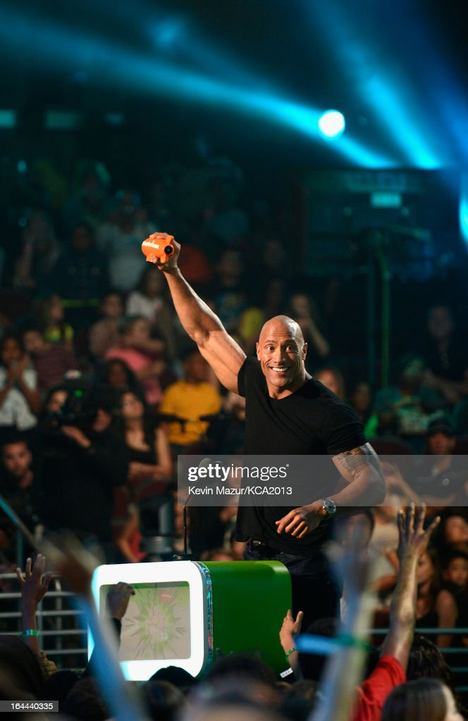 Actor <a gi-track='captionPersonalityLinkClicked' href=/galleries/search?phrase=Dwayne+Johnson&family=editorial&specificpeople=210704 ng-click='$event.stopPropagation()'>Dwayne Johnson</a> speaks onstage during Nickelodeon's 26th Annual Kids' Choice Awards at USC Galen Center on March 23, 2013 in Los Angeles, California.