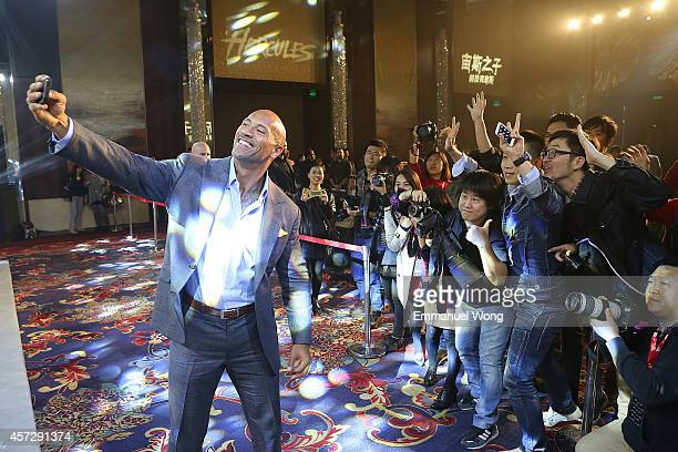 Actor Dwayne Johnson takes a Selfie on press conference of Paramount Pictures 'HERCULES' at The China World Summit Wing Hotel on October 16 2014 in...