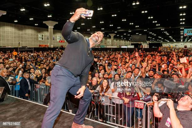 Actor Dwayne Johnson takes a selfie with the crowd at ENTERTAINMENT WEEKLY Presents Dwayne 'The Rock' Johnson at Stan Lee's Los Angeles ComicCon at...