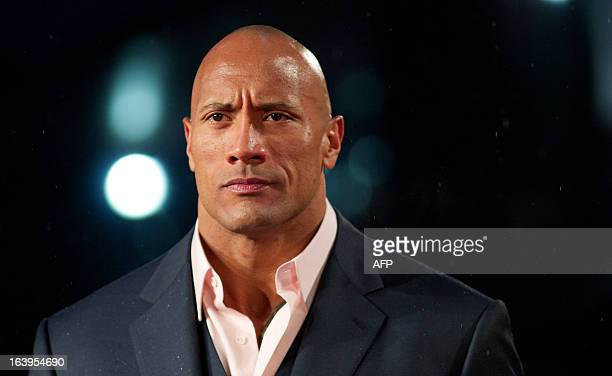 US actor Dwayne Johnson 'The Rock' poses for pictures on the red carpet as he arrives for the 'G I Joe Retaliation' UK film Premiere in central...