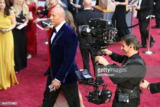 Actor Dwayne Johnson walks down the red carpet at the 89th Annual Academy Awards at Hollywood Highland Center on February 26 2017 in Hollywood...