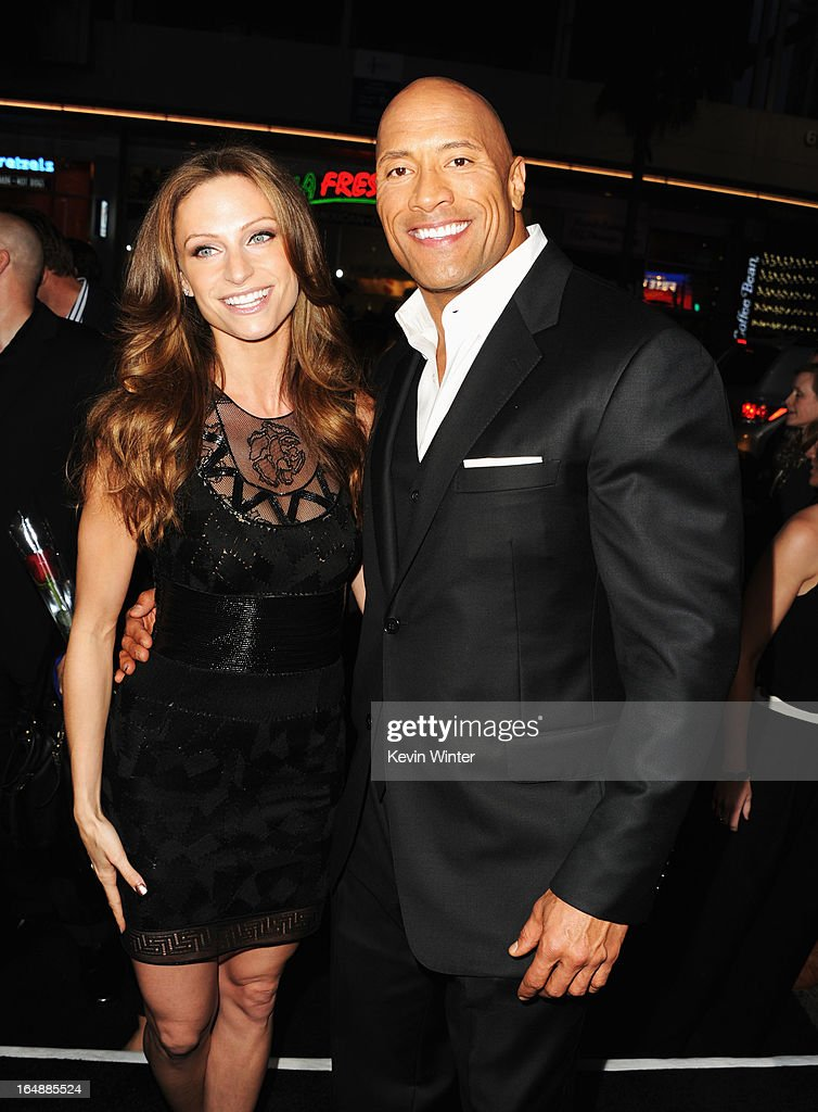 Actor Dwayne 'The Rock' Johnson (R) and Lauren Hashian attend the premiere of Paramount Pictures' 'G.I. Joe:Retaliation' at TCL Chinese Theatre on March 28, 2013 in Hollywood, California.