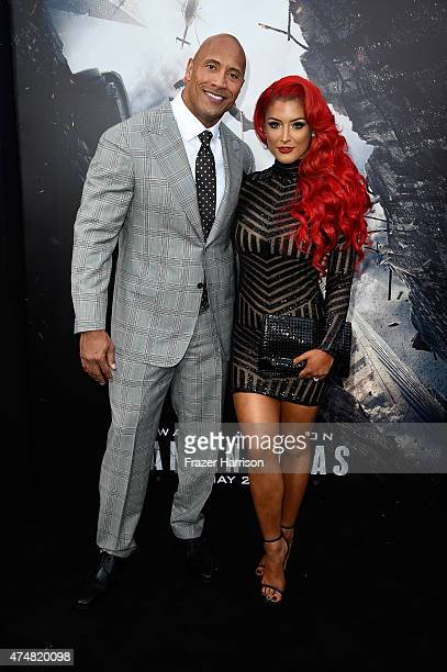 Actor Dwayne 'The Rock' Johnson and model/TV personality Eva Marie attend the premiere of Warner Bros Pictures' 'San Andreas' at the TCL Chinese...