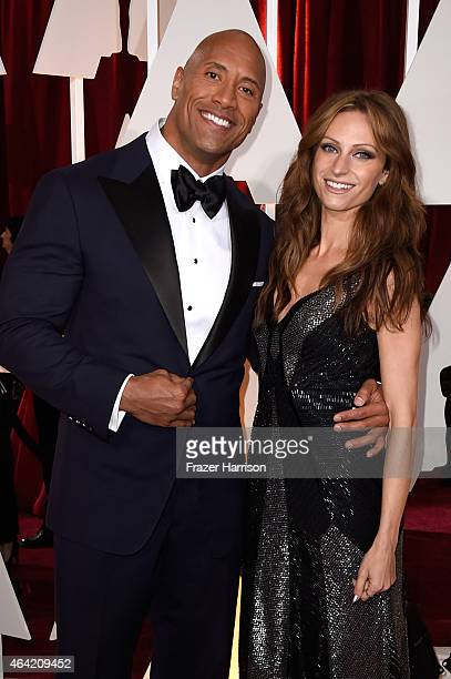 Actor Dwayne 'The Rock' Johnson and singer Lauren Hashian the 87th Annual Academy Awards at Hollywood Highland Center on February 22 2015 in...