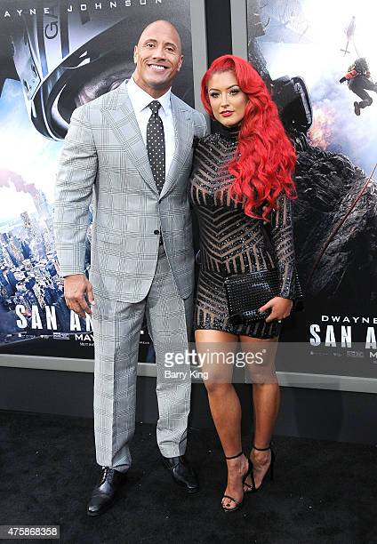 Actor Dwayne 'The Rock' Johnson and tv personality Eva Marie arrive at the premiere of Warner Bros Pictures 'San Andreas' at TCL Chinese Theatre on...