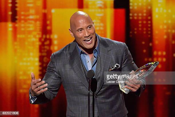 Actor Dwyane Johnson accepts an award onstage during the People's Choice Awards 2017 at Microsoft Theater on January 18 2017 in Los Angeles California
