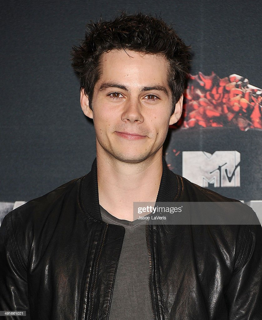 Actor Dylan O'Brien poses in the press room at the 2014 MTV Movie Awards at Nokia Theatre L.A. Live on April 13, 2014 in Los Angeles, California.