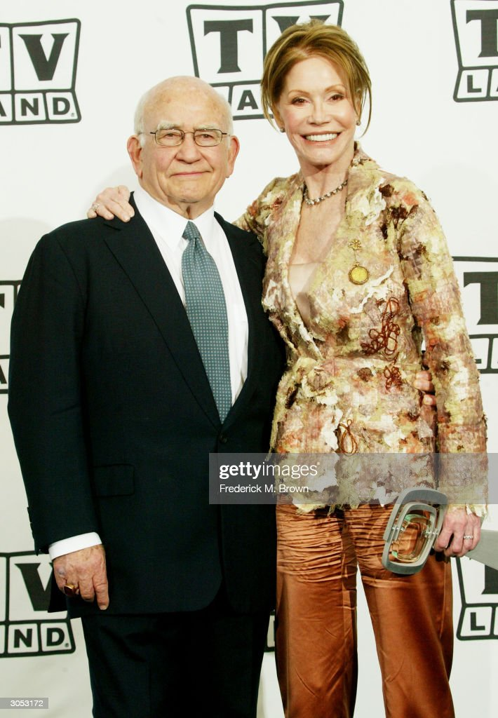 Actor Ed Asner and Discretionary Award for Ground Breaking Show 'The Mary Tyler Moore Show' winner, actress Mary Tyler Moore pose backstage at the 2nd Annual TV Land Awards held on March 7, 2004 at The Hollywood Palladium, in Hollywood, California.