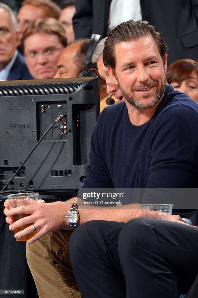 Actor Ed Burns watches the Charlotte Bobcats play against the New York Knicks during the game on November 5, 2013 at Madison Square Garden in New York City, New York.