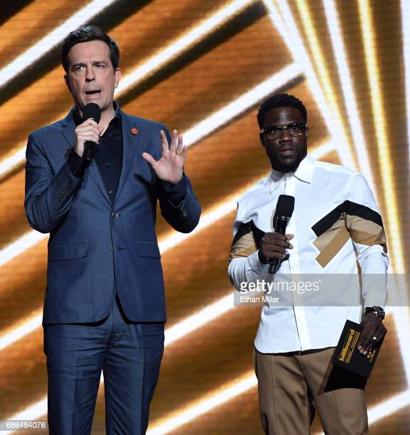 Actors Ed Helms and Kevin Hart speak onstage during the 2017 Billboard Music Awards at TMobile Arena on May 21 2017 in Las Vegas Nevada