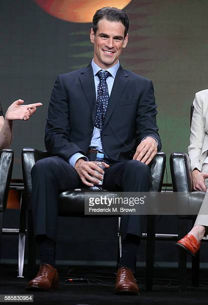 Actor Eddie Cahill speaks onstage at the 'Conviction' panel discussion during the Disney ABC Television Group portion of the 2016 Television Critics...