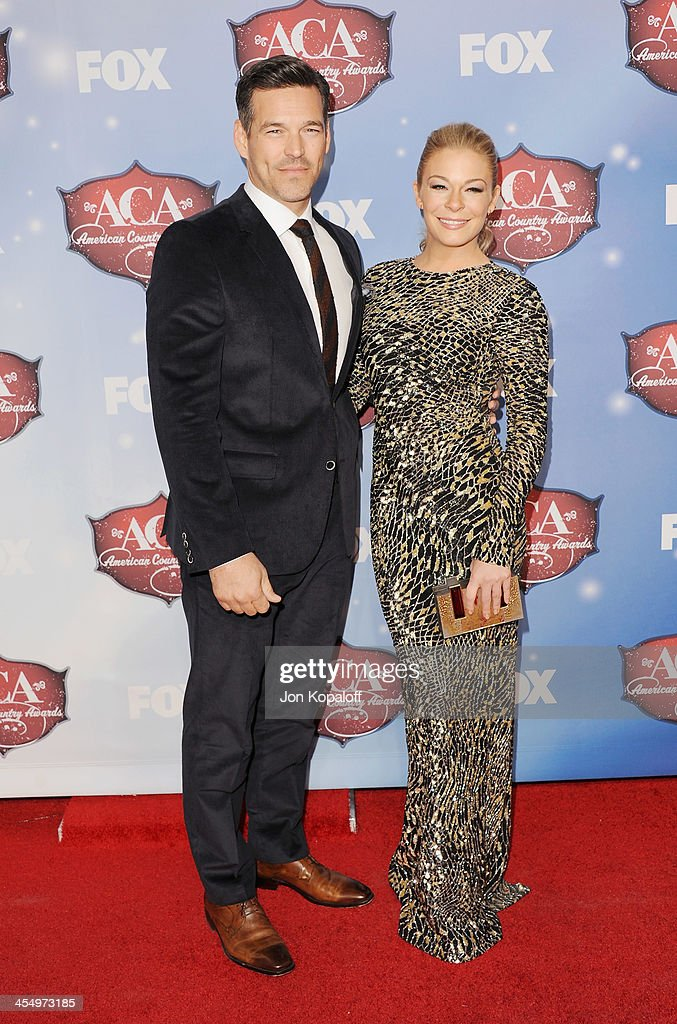 Actor <a gi-track='captionPersonalityLinkClicked' href=/galleries/search?phrase=Eddie+Cibrian&family=editorial&specificpeople=689383 ng-click='$event.stopPropagation()'>Eddie Cibrian</a> and wife singer <a gi-track='captionPersonalityLinkClicked' href=/galleries/search?phrase=LeAnn+Rimes&family=editorial&specificpeople=208815 ng-click='$event.stopPropagation()'>LeAnn Rimes</a> arrive at the American Country Awards 2013 at the Mandalay Bay Events Center on December 10, 2013 in Las Vegas, Nevada.