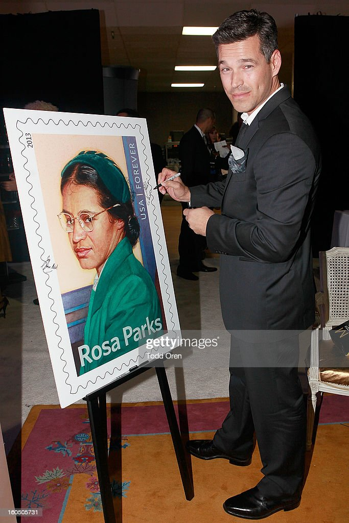 Actor <a gi-track='captionPersonalityLinkClicked' href=/galleries/search?phrase=Eddie+Cibrian&family=editorial&specificpeople=689383 ng-click='$event.stopPropagation()'>Eddie Cibrian</a> previews the Rosa Parks Forever Stamp in the U.S. Postal Service Civil Rights Stamp Gallery backstage at the NAACP Image Awards on February 1, 2013 at The Shrine Auditorium.
