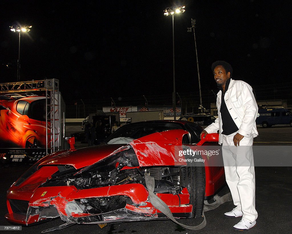 Actor eddie griffin poses beside the ferrari enzo that he crashed picture id73714612 actor eddie griffin poses beside the ferrari enzo that he crashed while participating in the redline vanachro Image collections
