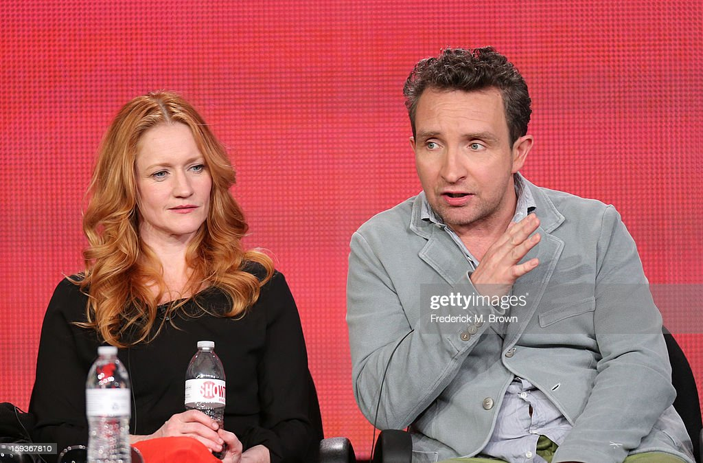 Actor Eddie Marsan of 'Ray Donovan' speaks onstage as actress Paula Malcomson looks on during the Showtime portion of the 2013 Winter TCA Tour at Langham Hotel on January 12, 2013 in Pasadena, California.