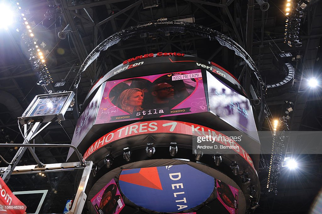 Actor Eddie Murphy and his guest are shown on the kiss cam during a game between the Phoenix Suns and the Los Angeles Lakers at Staples Center on November 16, 2012 in Los Angeles, California.