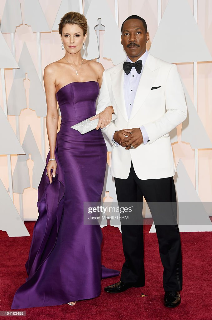 Actor <a gi-track='captionPersonalityLinkClicked' href=/galleries/search?phrase=Eddie+Murphy&family=editorial&specificpeople=203093 ng-click='$event.stopPropagation()'>Eddie Murphy</a> (R) and model <a gi-track='captionPersonalityLinkClicked' href=/galleries/search?phrase=Paige+Butcher&family=editorial&specificpeople=2343163 ng-click='$event.stopPropagation()'>Paige Butcher</a> attend the 87th Annual Academy Awards at Hollywood & Highland Center on February 22, 2015 in Hollywood, California.