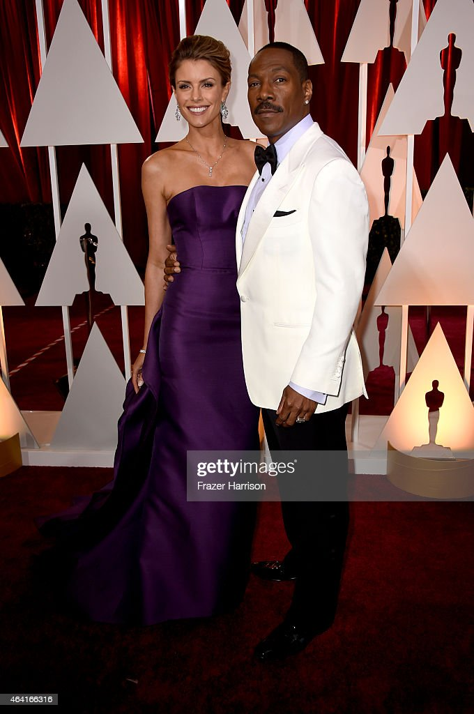 Actor Eddie Murphy and Paige Butcher attend the 87th Annual Academy Awards at Hollywood Highland Center on February 22 2015 in Hollywood California