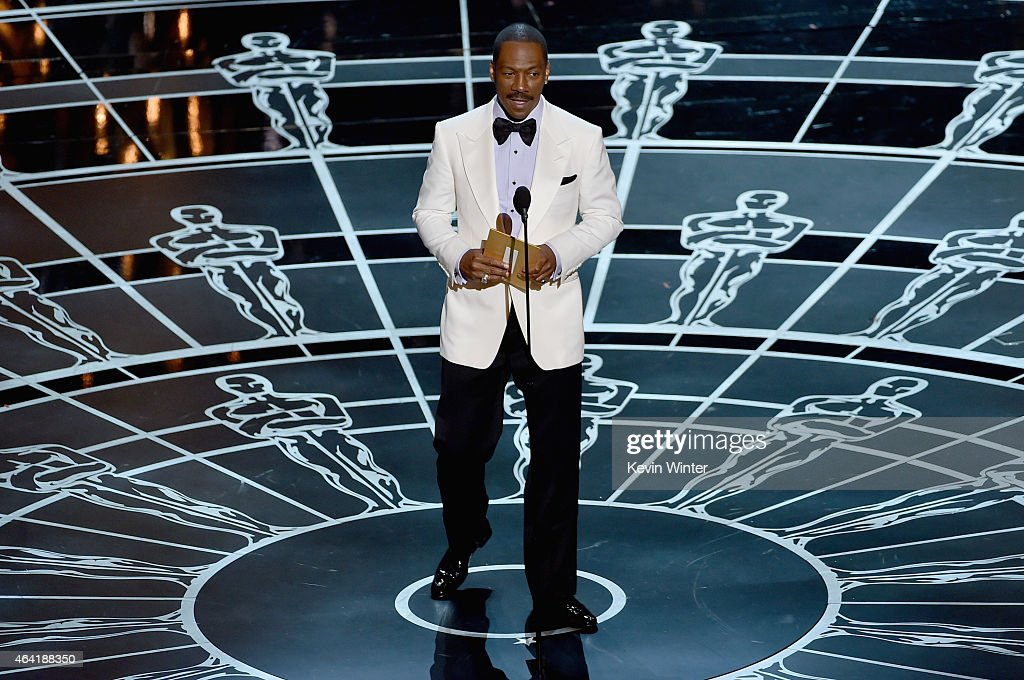Actor Eddie Murphy opens the envelope onstage during the 87th Annual Academy Awards at Dolby Theatre on February 22 2015 in Hollywood California