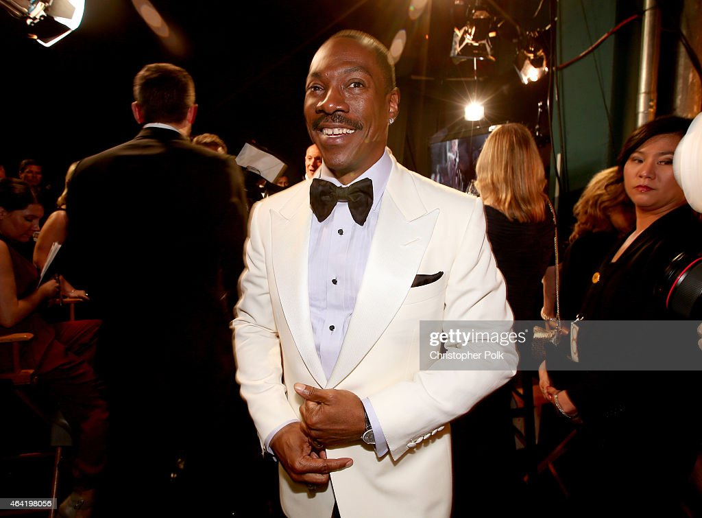 Actor <a gi-track='captionPersonalityLinkClicked' href=/galleries/search?phrase=Eddie+Murphy&family=editorial&specificpeople=203093 ng-click='$event.stopPropagation()'>Eddie Murphy</a> smiles backstage during the 87th Annual Academy Awards at Dolby Theatre on February 22, 2015 in Hollywood, California.