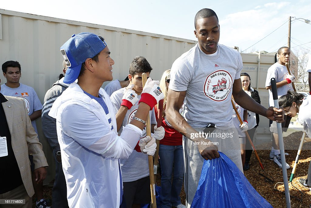 Actor Eddie Peng meets Dwight Howard #12 of the Los Angeles Lakers at the 2013 NBA Cares Day of Service at the Playground Build with KaBOOM! on February 15, 2013 in Houston, Texas.