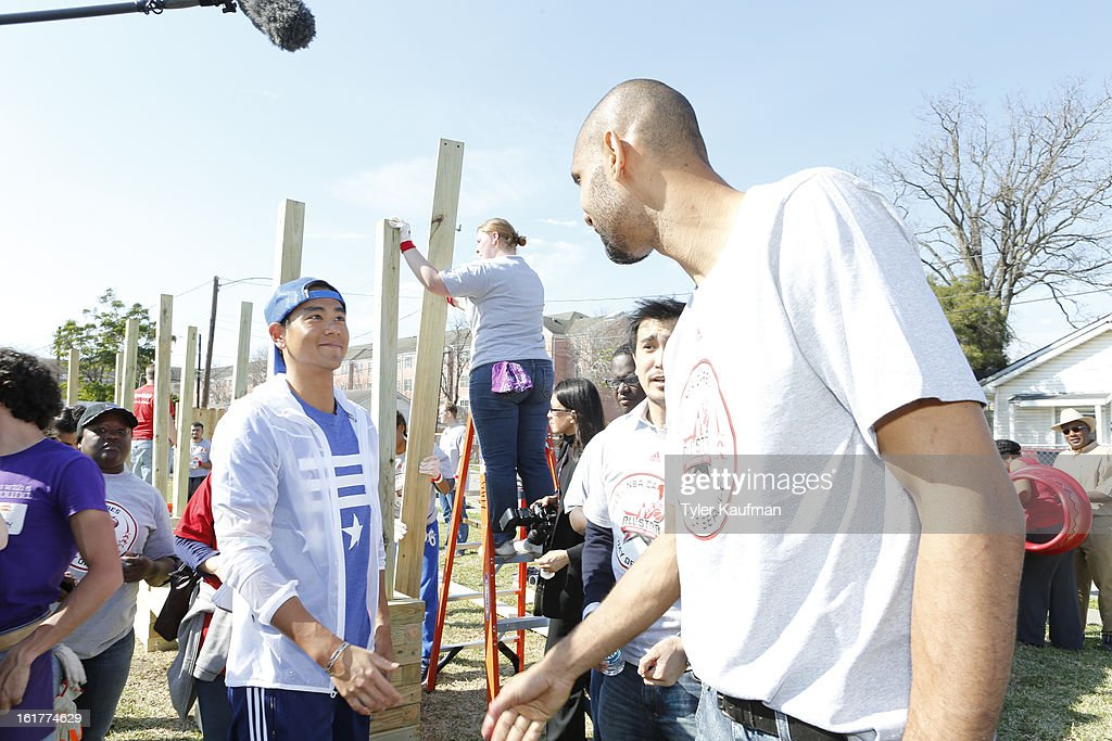 Actor Eddie Peng meets Tim Duncan #21 of the San Antonio Spurs at the 2013 NBA Cares Day of Service at the Playground Build with KaBOOM! on February 15, 2013 in Houston, Texas.