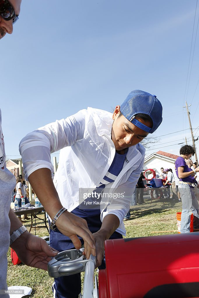 Actor Eddie Peng participates at the 2013 NBA Cares Day of Service at the Playground Build with KaBOOM! on February 15, 2013 in Houston, Texas.