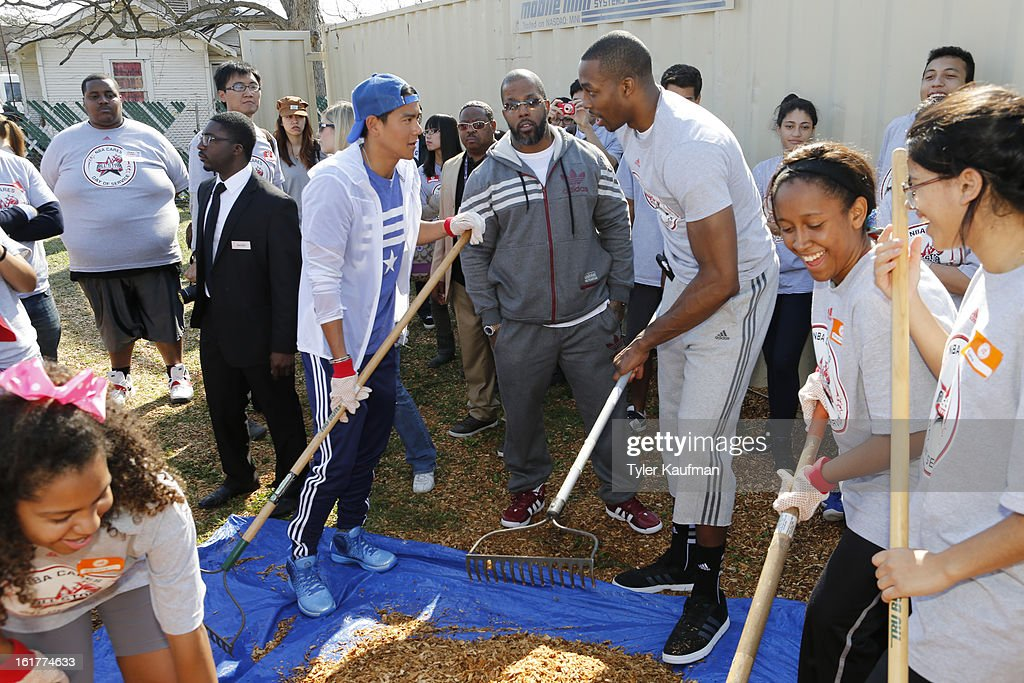 Actor Eddie Peng works with Dwight Howard #12 of the Los Angeles Lakers at the 2013 NBA Cares Day of Service at the Playground Build with KaBOOM! on February 15, 2013 in Houston, Texas.