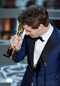 Actor Eddie Redmayne accepts the Best Actor in a Leading Role Award for 'The Theory of Everything' onstage during the 87th Annual Academy Awards at...