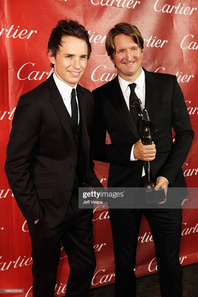 Actor Eddie Redmayne and Director Tom Hooper poses with the Sonny Bono Visionary Award during the 24th annual Palm Springs International Film Festival Awards Gala at the Palm Springs Convention Center on January 5, 2013 in Palm Springs, California.