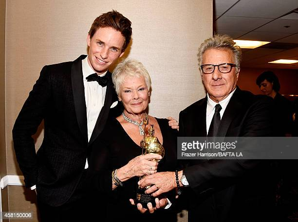 Actor Eddie Redmayne honoree Dame Judi Dench and actor Dustin Hoffman attend the BAFTA Los Angeles Jaguar Britannia Awards presented by BBC America...