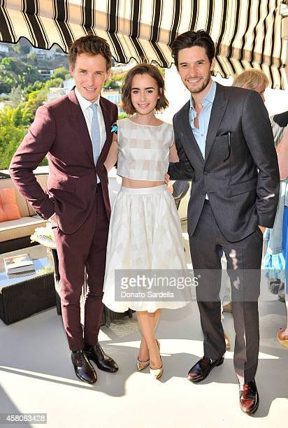 Actor Eddie Redmayne wearing Burberry actress Lily Collins and actor Ben Barnes wearing Burberry at Eddie Redmayne Vanity Fair And Burberry Celebrate...