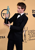 Actor Eddie Redmayne winner of Outstanding Performance by a Male Actor in a Leading Role for 'The Theory of Everything' poses in the press room at...