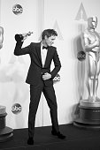 Actor Eddie Redmayne winner of the Best Actor in a Leading Role Award for 'The Theory of Everything' appears in the press photo room at the 87th...