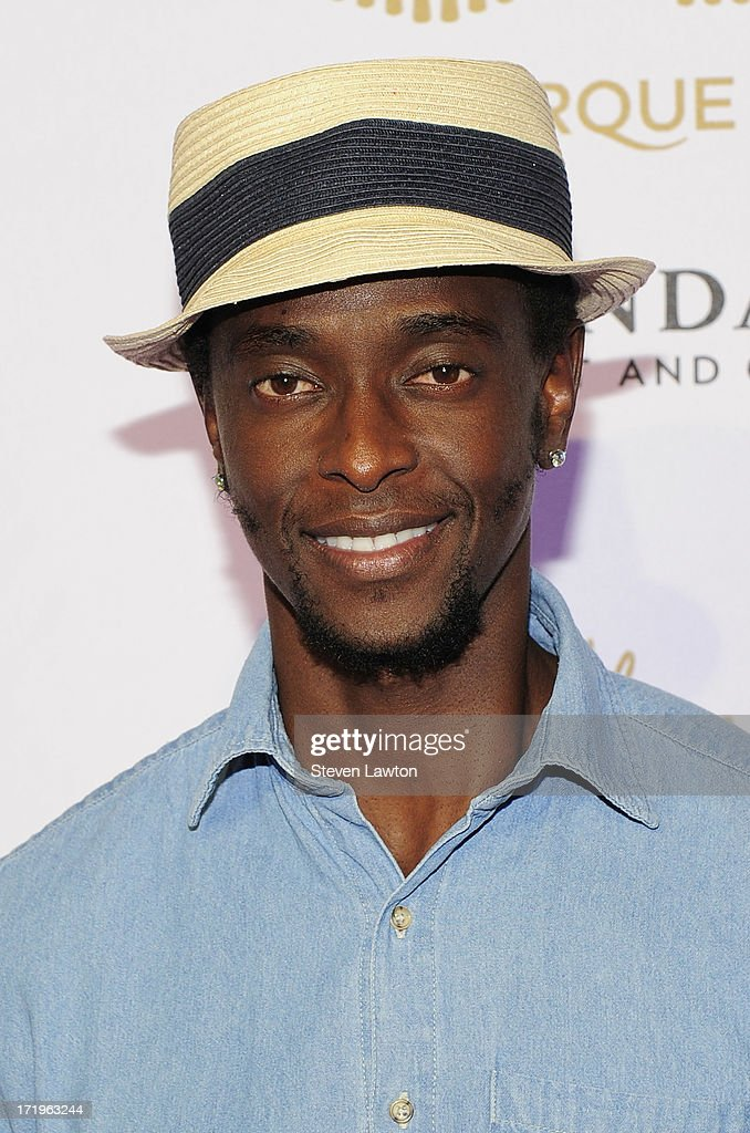 Actor <a gi-track='captionPersonalityLinkClicked' href=/galleries/search?phrase=Edi+Gathegi&family=editorial&specificpeople=4327719 ng-click='$event.stopPropagation()'>Edi Gathegi</a> arrives at the world premiere of 'Michael Jackson ONE by Cirque du Soleil' at THEhotel at Mandalay Bay on June 29, 2013 in Las Vegas, Nevada.
