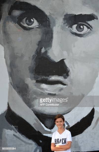 Actor Edouard Holdener poses for a photo in front of a portrait of Charlie Chaplin in Los Angeles California September 8 2017 From scifi horror...
