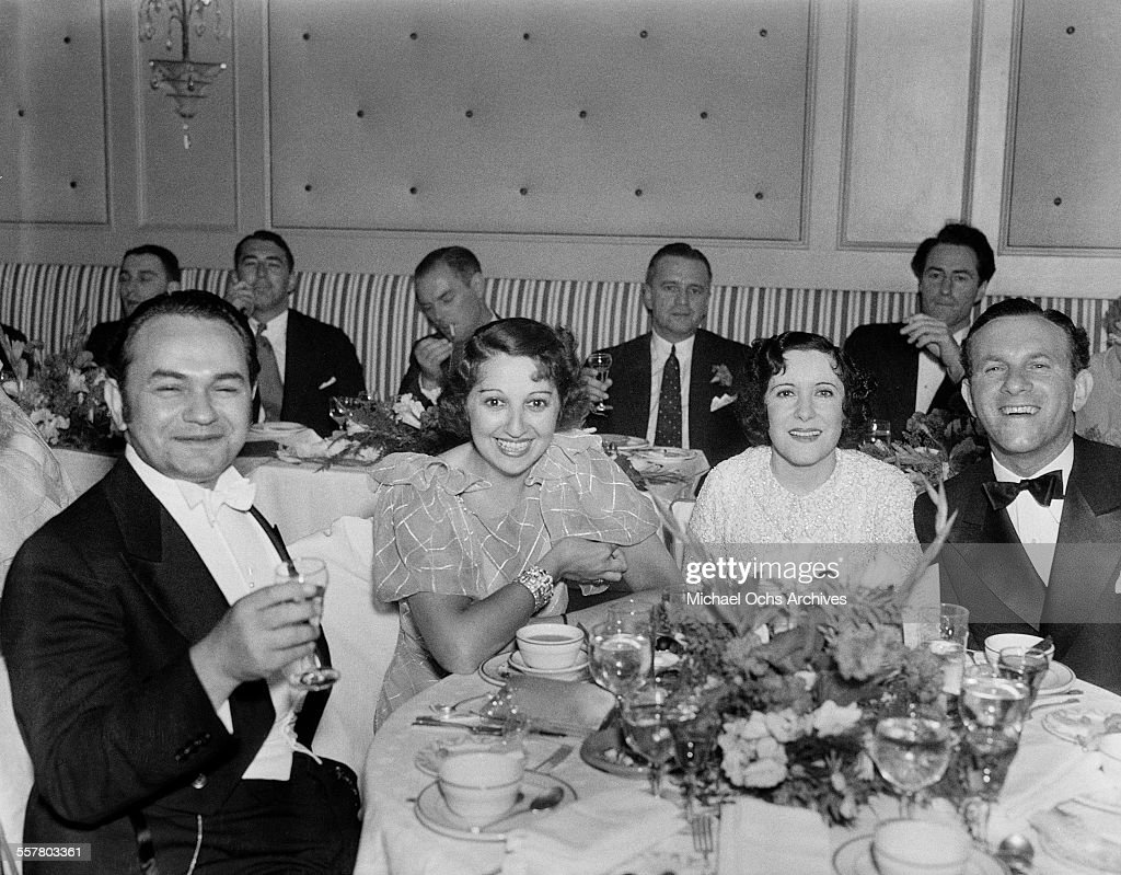 Actor Edward G Robinson Mary Livingston Gracie Allen and George Burns pose at dinner at the Trocadero in Los Angeles California