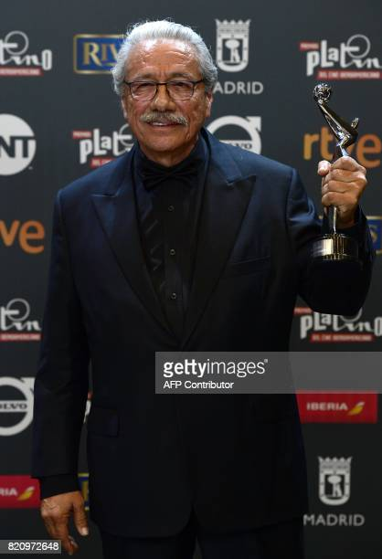 US actor Edward James Olmos holds up his honour trophy during the 4th edition of the 'Premios Platino' for IberoAmerican Cinema in Madrid on July 22...
