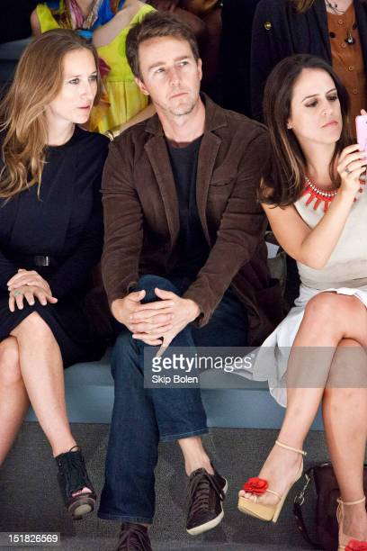 Actor Edward Norton watches a model on the runway at the Osklen show during Spring 2013 MercedesBenz Fashion Week at The Stage Lincoln Center on...